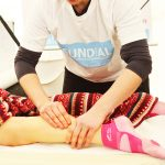 Massage on runners calf and Achilles tendon