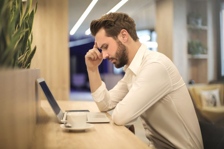 Man with poor posture at table at risk of back pain