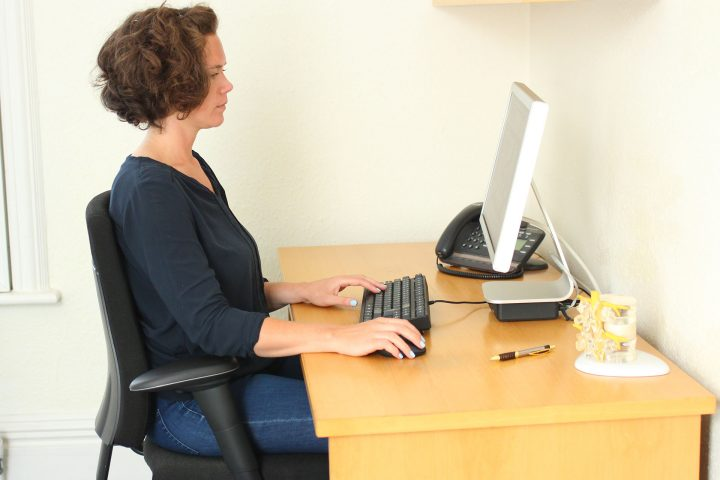 Brighton chiropractor demonstrates best office chair for a bad back