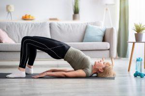 Woman doing bridge exercise for back pain